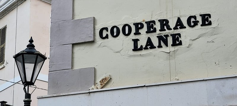 Old cast iron street sign at Cooperage Lane at its junction with Main Street (November 2020).